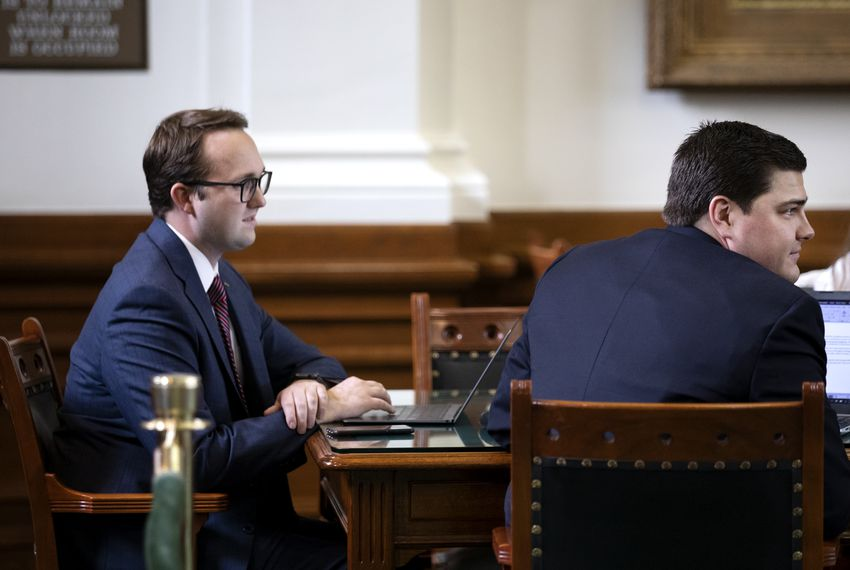 Destin Sensky and Brandon Waltens, two employees of Texas Scorecard, a product of the influential political group Empower Texans, sit at the Senate press table.