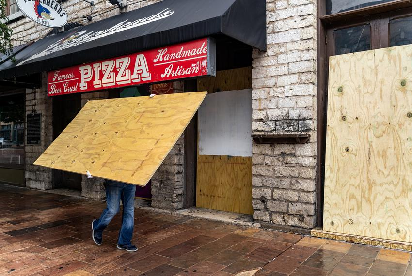 Workers boarded up bars on Sixth Street in Austin after Gov. Greg Abbott closed bars in Texas for the second time in three m…