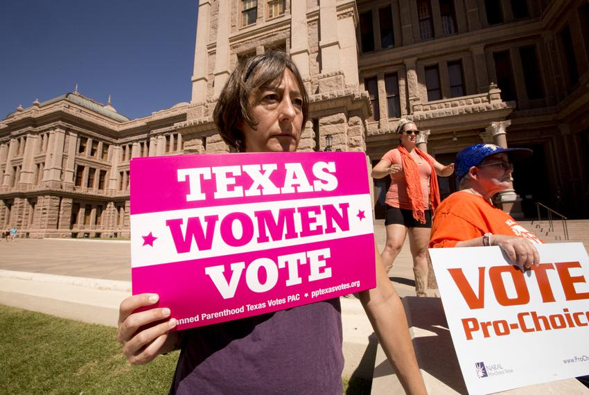 A day after a federal appeals court allowed Texas to begin enforcing new abortion restrictions, a group protested the ruling…