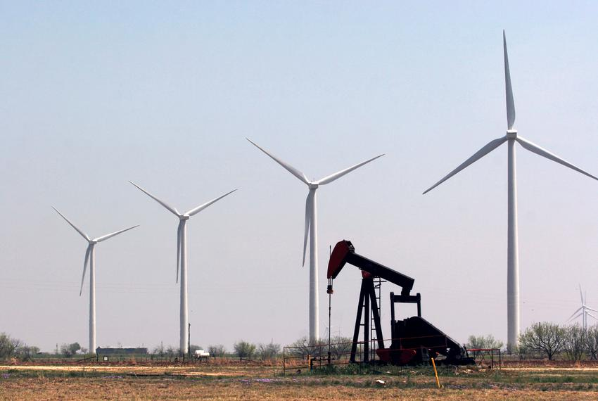 A working pump jack on the Cline Shale sits among wind turbines that cover the landscape off FM 153 south of Sweetwater.