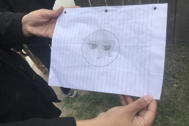 "A 10-year-old girl's sketch of herself after her father was deported. ""I felt like I was missing something, and that was part of my heart,"" the girl wrote."