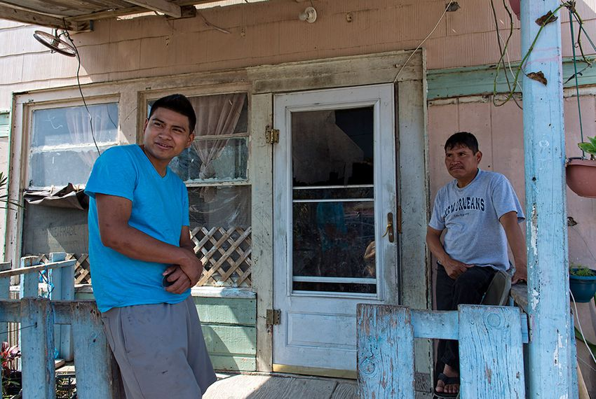 L to R:  Martin Gomez Jr. and his father Martin Gomez Sr. both work, but make so little that they aren't interested in buying healthcare insurance. The Gomez family lives in a colonia near Alton.