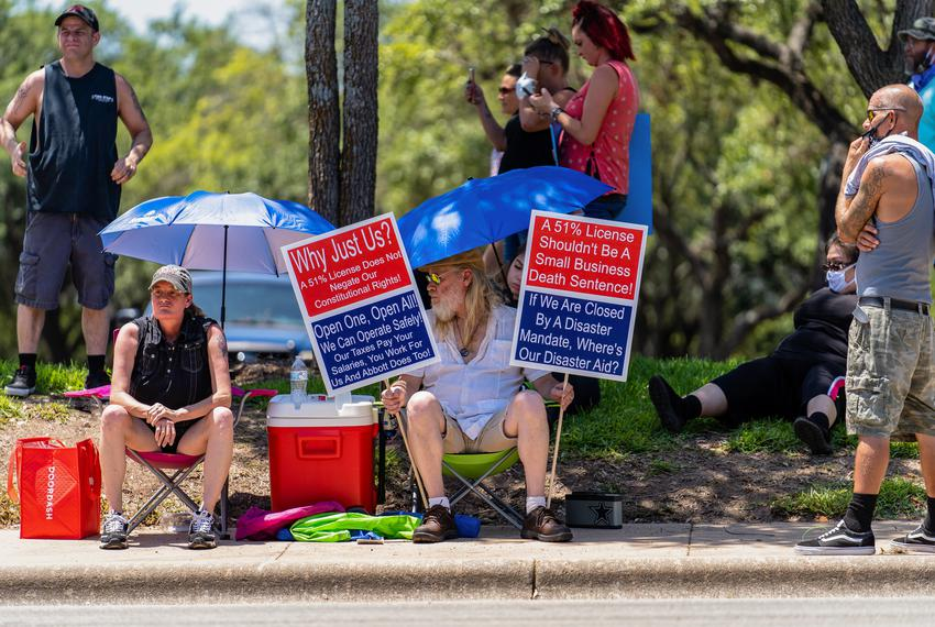 Bar owners and advocates gathered outside TABC headquarters in northwest Austin to protest the continued closure of bars on …
