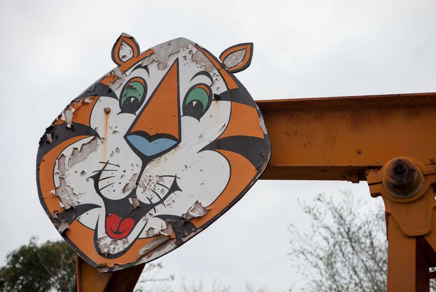 A pump jack tiger faces U.S. 183 off of Lamar Street.
