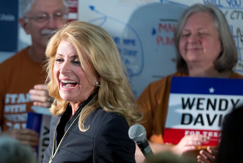 Governor candidate Wendy Davis thanks her supporters Oct. 22, 2014 prior to their block walking on her behalf in Travis Co...