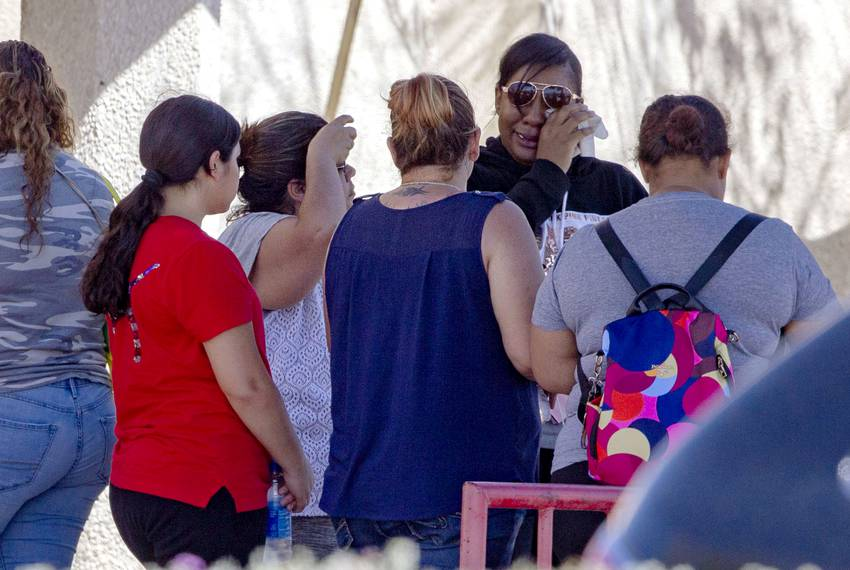 On Sunday, friends, family members, and strangers comfort each other at a family reunification site set up at MacArthur El...