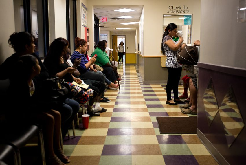 Patients wait to be seen at the People's Community Clinic in Austin, which provides state-subsidized health services to low-income families and individuals.