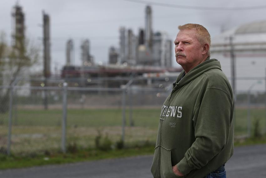 Dave Leining, who was badly injured in the 2005 BP refinery explosion, stands outside of the refinery which is currently own…