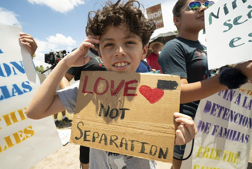 Santiago Martinez Alvarez joins his family in protesting family-separation policies during a vigil outside the Ursula Border…