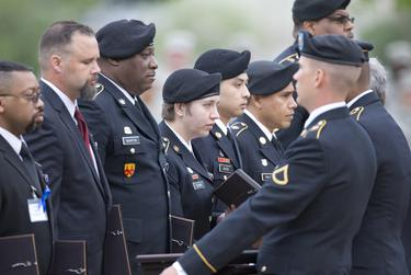 SSG Joy Clark (Nelson), center, and other Purple Heart recipients receive their awards during the Fort Hood ceremony.
