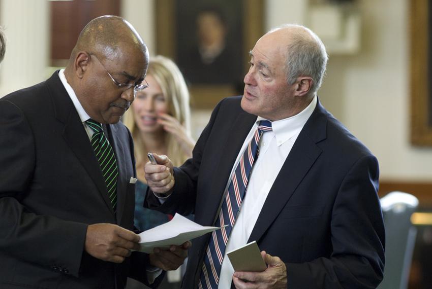 Sen. Kel Seliger (r), R-Amarillo, solicits support from Sen. Rodney Ellis (l), D-Houston, during Senate action on March 29, …