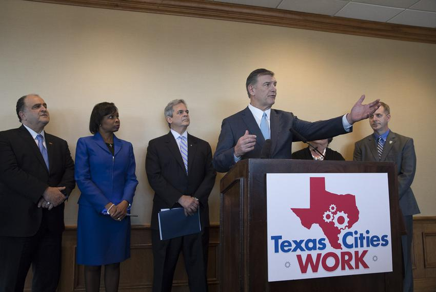 Dallas Mayor Mike Rawlings was among a group of Texas mayors at a Feb. 17, 2017, news conference discussing their unified ag…