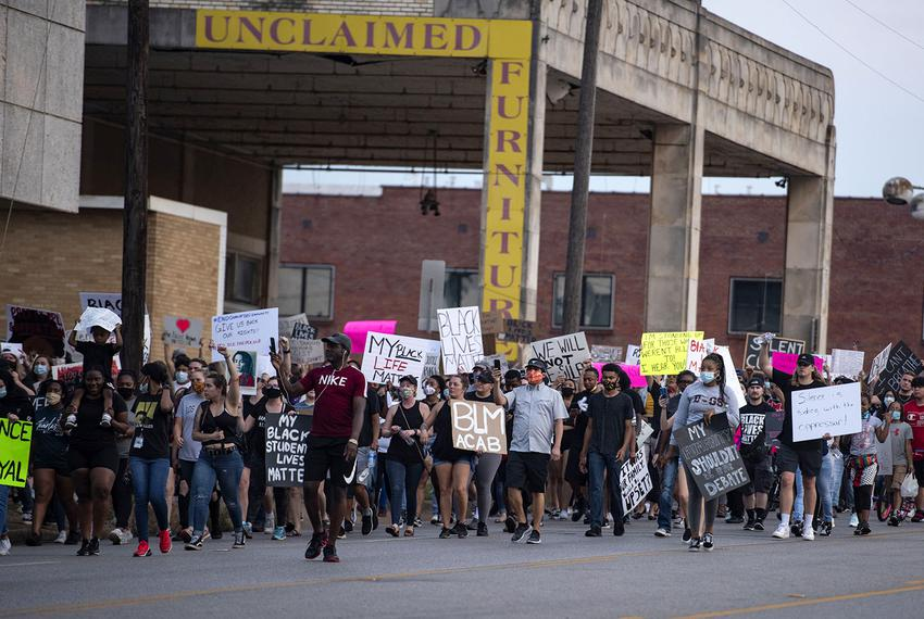 Demonstrators march in Tyler to protest the death of George Floyd on Monday, June 1, 2020.