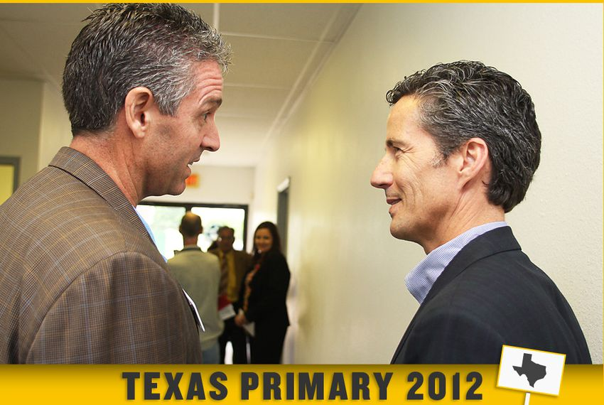 Texas State Reps Todd Smith - on left - and Kelly Hancock speak in the hallway outside a candidates forum they took part in that was held in Grand Prairie TX.