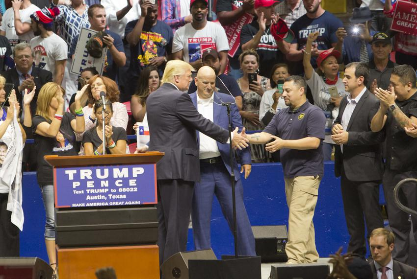 Republican Presidential nominee, Donald Trump greets a group of border patrol agents on stage during an August 23, 2016 rall…