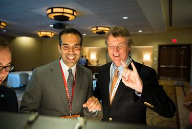 Incoming Texas Land Commissioner George P. Bush and UT-Austin President Bill Powers sent out a joint tweet at The Texas Tribune Festival on Sept. 19, 2014.