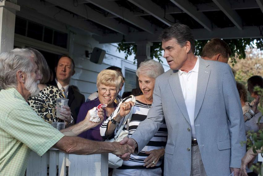 Presidential hopeful Texas Governor Rick Perry campaigns at a private reception in Cedar Rapids, Iowa on Monday evening Augu…