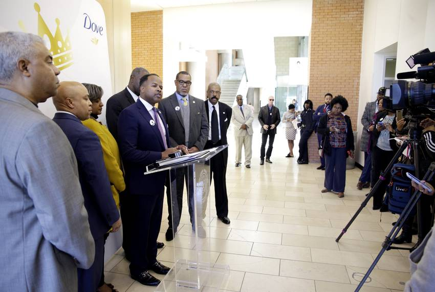Members of the Texas Legislative Black Caucus look on as state Rep. Ron Reynolds, R-Missouri City, speaks at a press confe...
