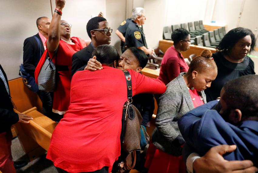 Members of Botham Jean's family rejoice in the courtroom after former Dallas police officer Amber Guyger was found guilty of…