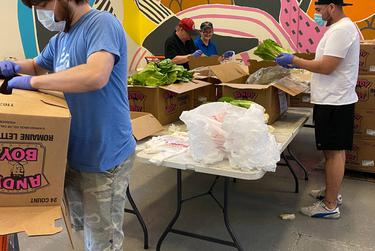 Volunteers at the CitySquare Food Bank in Dallas help unpack a shipment of produce.