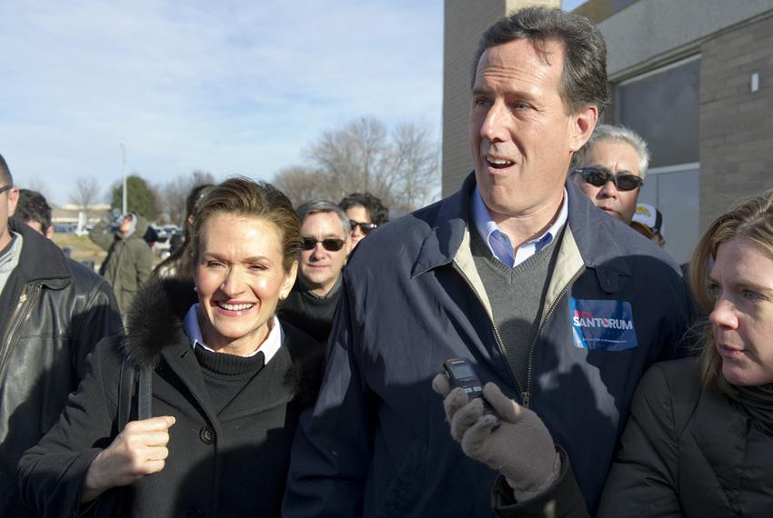 Rick Santorum and his wife, Karen, enter Valley High School in Des Moines for a speech the day of the Iowa caucuses, Jan. 3,…