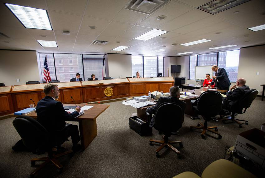 Administrative Law Judge Beth Bierman listens to testimony while Ron S. Rainey questions a witness  at a hearing in Austin...