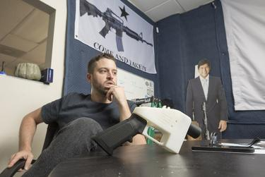 Cody Wilson, gun maker and founder of Defense Distributed, a Texas-based company developing and publishing open source gun designs for 3D printing and manufacture. Wilson shows The Liberator, a 3D printed plastic gun made several years ago.