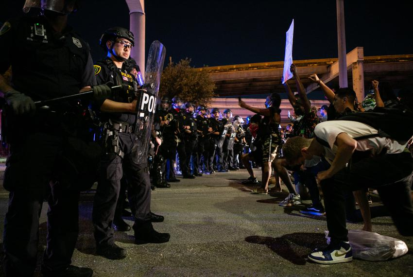 Police officers engage in a standoff with protesters Tuesday night in Houston, Texas.