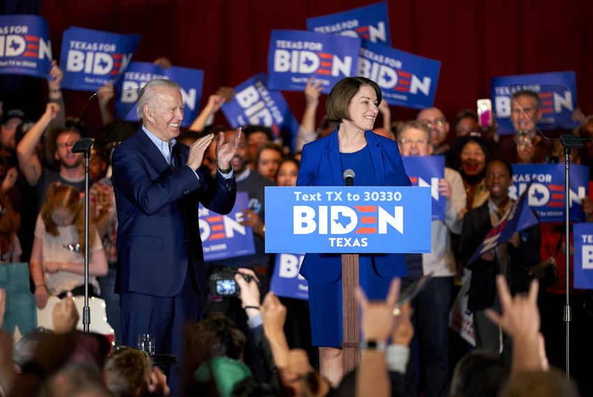 Democratic presidential candidate Joe Biden looks on as former candidate Amy Klobuchar speaks at a rally in Dallas on Mond...