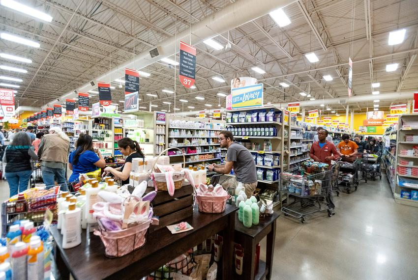 A long line forms at an H-E-B grocery store in Austin on March 13, 2020.