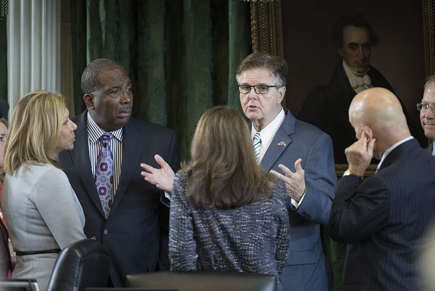 Lt. Gov. Dan Patrick confers with a group of senators during the special session on July 19, 2017.