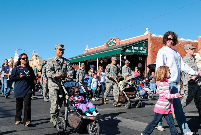 Service members and their families from Goodfellow Air Force Base, Texas, participate in the Veterans Day parade in San Ange…
