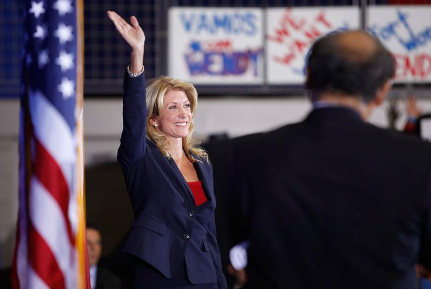 State Sen. Wendy Davis, D-Fort Worth, announces her campaign for governor in front of a crowd of supporters in Haltom City o…