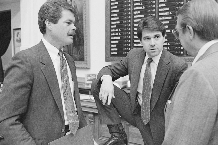 State Rep. Rick Perry is shown on April 13, 1989, on the Texas House floor with state Rep. Pete Laney (right) and Rep. Ron Lewis the floor of the house during the 71st Legislative Session.