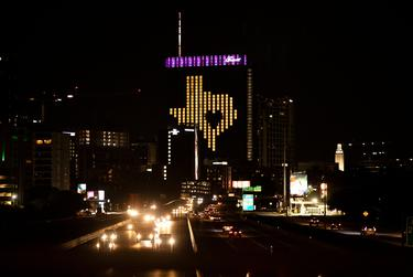 A downtown Austin building showed the state of Texas with a heart inside during the early days of the coronavirus pandemic in the state.
