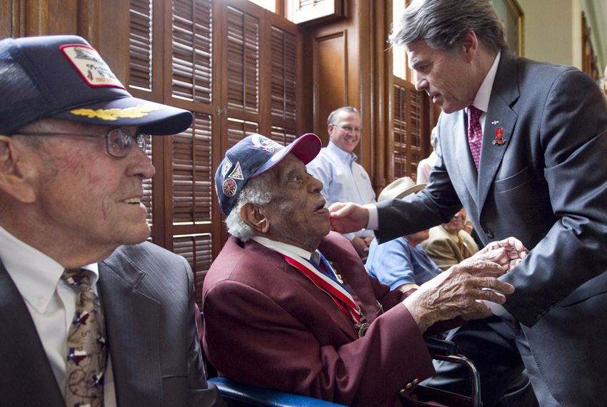 Gov. Perry greets veteran Thomas Ellis as Perry's father Ray Perry smiles during a ceremony commemorating World War Two veterans on the Senate floor on May 8, 2013.