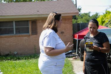 Julie Johnson knocked on doors and spoke to residents in a neighborhood near Don Showman Park on August 18, 2018 to ask for support in her race for Texas House District 115.