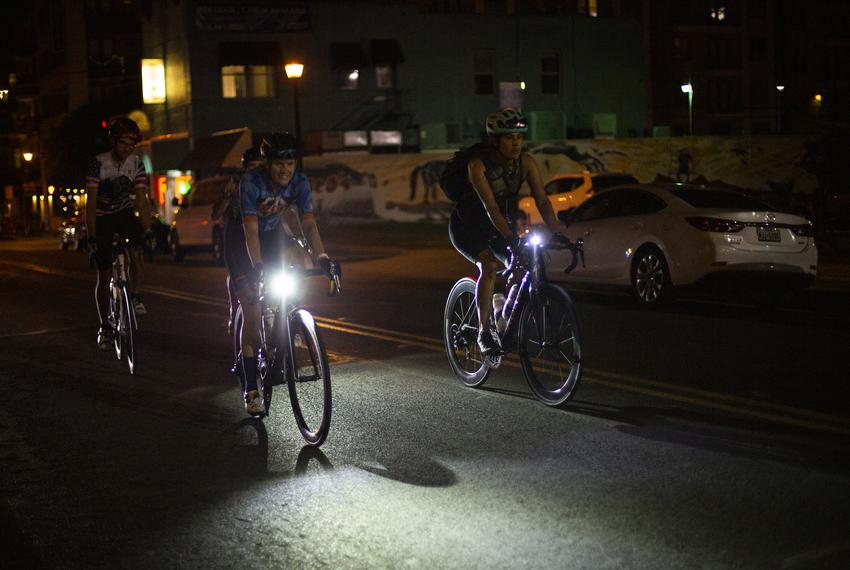 A group of cyclists rides down East Sixth Street near Comal Street in Austin on June 9, 2021.
