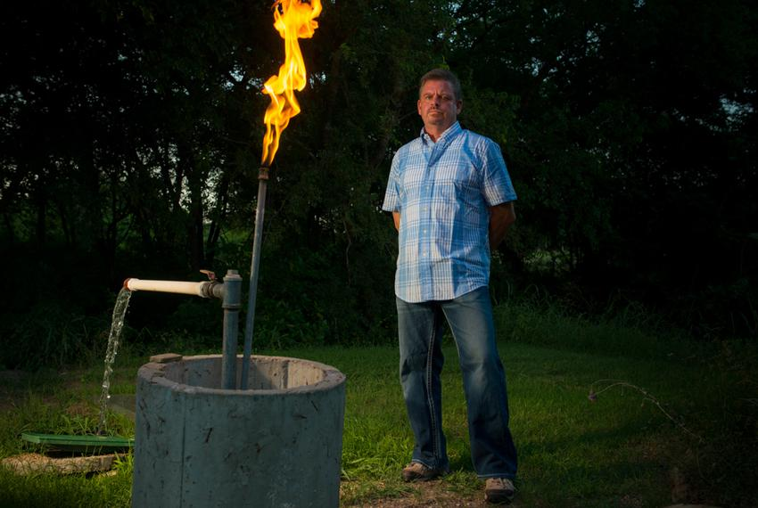 Steve Lipsky shows the methane contamination of his well by igniting the gas with a lighter outside his family's home in Par…
