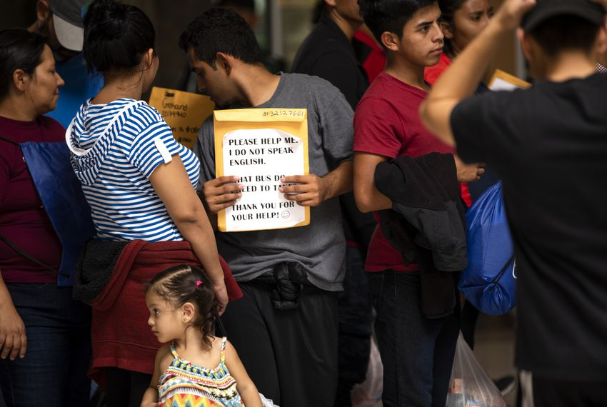 Migrants secure tickets at the McAllen bus station.