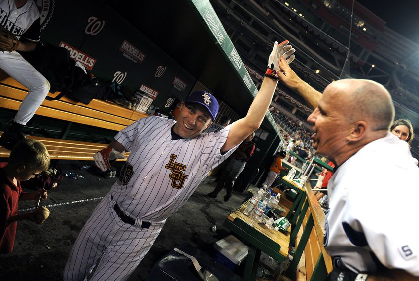 Rep. Steve Scalise, R-La., left, gets encouragement from Rep Kevin Brady, R-Texas, at the annual Congressional Baseball, won by the Republicans, July 17, 2008.