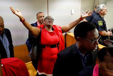 Botham Jean's mother, Allison Jean, rejoices in the courtroom after former Dallas police officer Amber Guyger was found guilty of murder by a 12-person jury in the 204th District Court at the Frank Crowley Courts Building in Dallas on U.S. Oct. 1, 2019.
