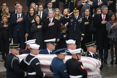 The Bush family looked on as a joint military services honor guard carried the casket for former President George H.W. Bush  from the Union Pacific funeral train at Texas A&M University in College Station.