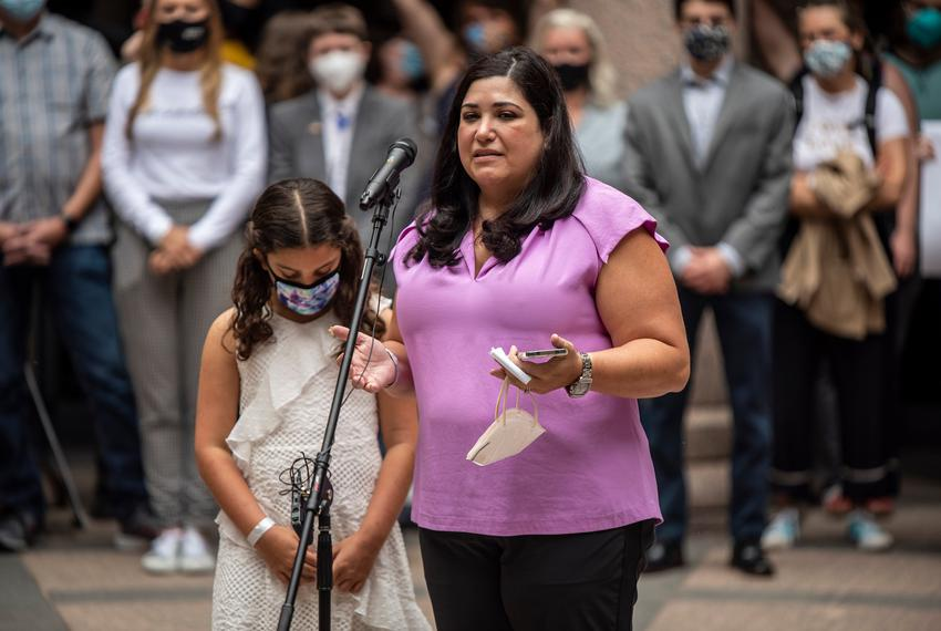 Lisa Stanton, with her daughter Maya, spoke at an event held by Equality Texas at the Capitol on April 14, 2021. The group h…
