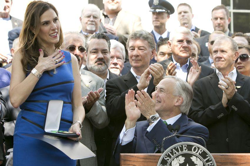 Taya Kyle receives the Texas Legislative Medal of Honor that Gov. Greg Abbott awarded to her late husband, Chris Kyle, on Aug. 26, 2015.