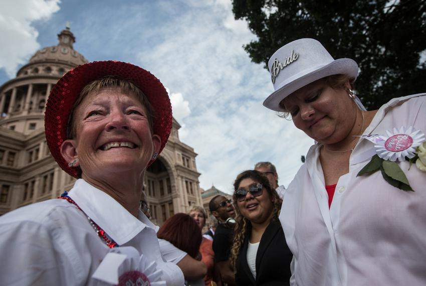 Kristin Taber and Pamela Holwerda, who travelled to Austin from Bell County, are pictured moments after being legally marrie…