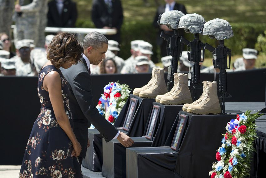 President Barack Obama and First Lady Michelle Obama pay respects to soldiers killed during a Fort Hood ceremony on April 9, 2014.