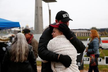 Supporters console each other after presidential candidate Beto O'Rourke announced his withdrawal from the race, in Des Moines, Iowa on Nov. 1, 2019.