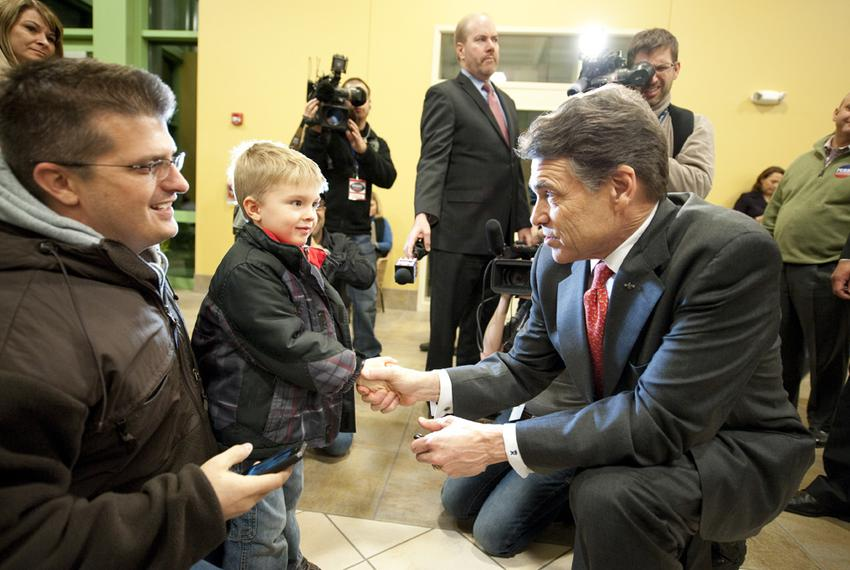 Rick Perry greets Griffin Mann at the Point of Grace Church  Iowa caucus in Waukee, Iowa on January 3, 2012.