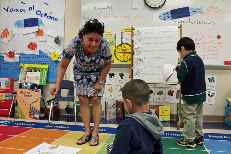 Teacher Silvia Corado works with students in her pre-kindergarten class as they learn syllables and word identification, part of the Summer Bilingual Academy at Wilson Elementary School in San Antonio.